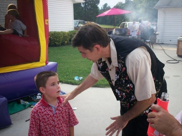 Charlotte Magician, Zelnik performs for families.